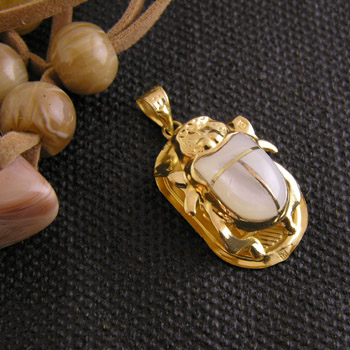 Gold scarab with white stone (jewelry gifts)