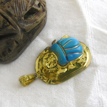 Gold scarab with turquoise stone (jewelry gifts)