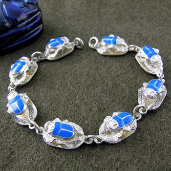 several silver scarabs links bracelet